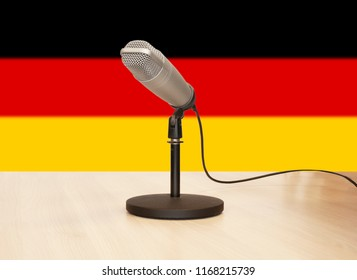 Microphone in front of the flag of Germany