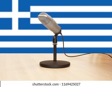 Microphone in front of the flag of Greece