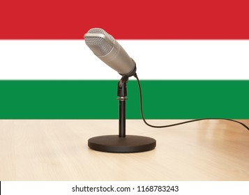 Microphone in front of the flag of Hungary