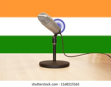 Microphone in front of the flag of India