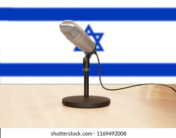 Microphone in front of the flag of Israel