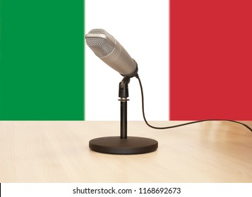 Microphone in front of the flag of Italy