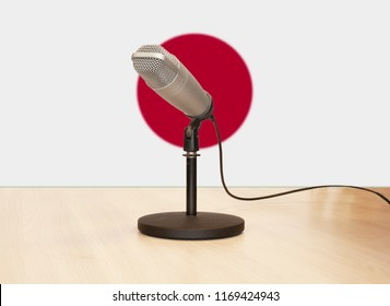 Microphone in front of the flag of Japan