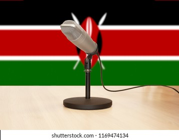 Microphone in front of the flag of Kenya