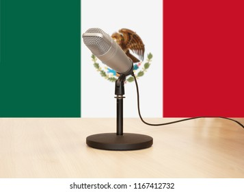 Microphone in front of the flag of Mexico