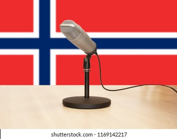 Microphone in front of the flag of Norway