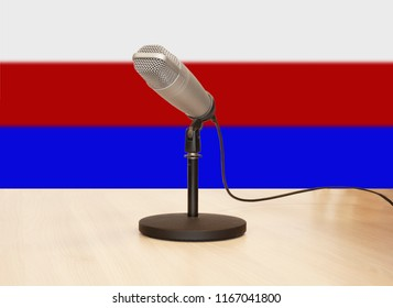 Microphone in front of a flag of the russian federation