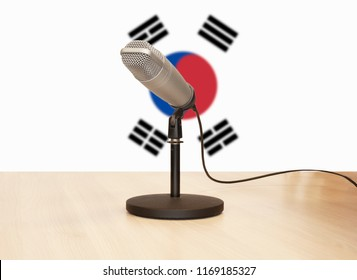Microphone in front of the flag of South Korea