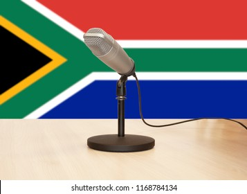 Microphone in front of the flag of South-Africa