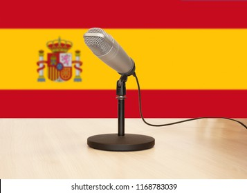 Microphone in front of the flag of Spain