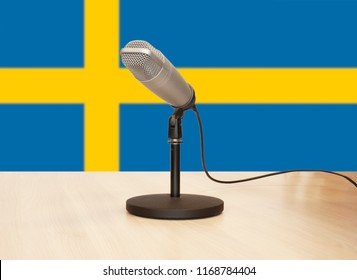 Microphone in front of the flag of Sweden
