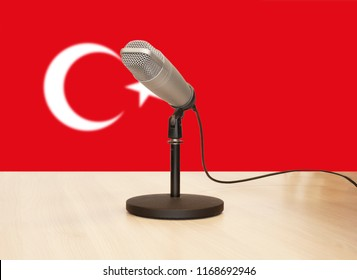 Microphone in front of the flag of Turkey