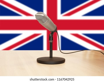 Microphone in front of a flag of the United Kingdom
