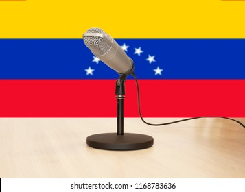 Microphone in front of the flag of Venezuela