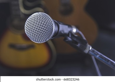Microphone and Guitar Background.