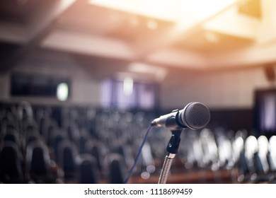 Microphone in hall concert, chair blurred background