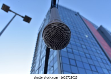Microphone hanging next to a building