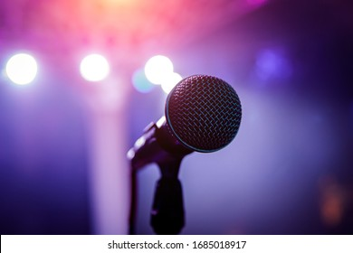 Microphone head on stage in a dark room