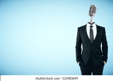 Microphone headed businessman on blue background with copy space. Speech concept