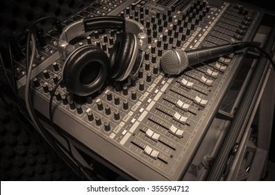 microphone ,headphone on sound mixer background.