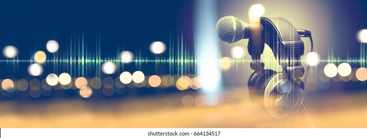 Microphone and headphones.Live music and blurred stage lights. Music background