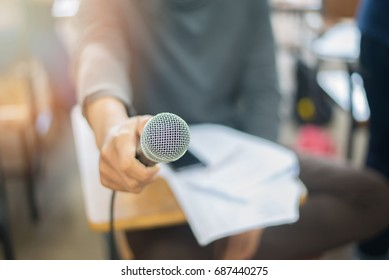 Microphone holds by news reporter, teacher, student, or business person. This microphone image is useful for business magazine, website, books, or any media related to sound system, speaking, singing