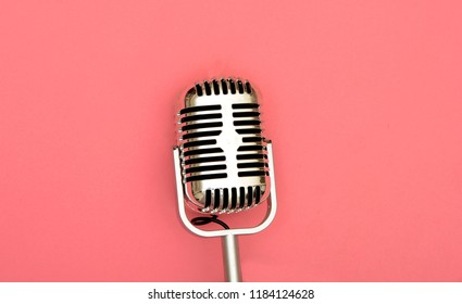 Microphone image on pink background, old vintage style.