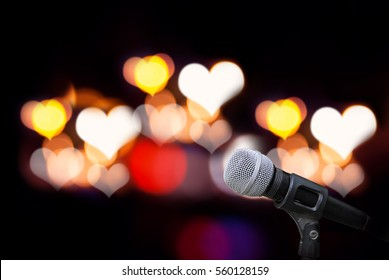 Microphone isolate on heart bokeh outdoor background