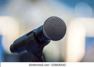 Microphone isolated closeup illustrative image for conference, convention, musical concert, public performance, show, music recording studio concept. Democracy, freedom of speech concept.