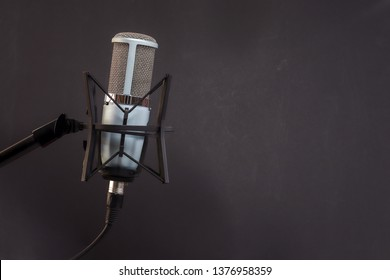 microphone isolated on black background (Mic, condencer Mic, Voice Mic, Instrument Mic, Studio Mics, Microphones, condencer Microphone, Voice Microphone, Instrument Microphone, Studio Microphones)