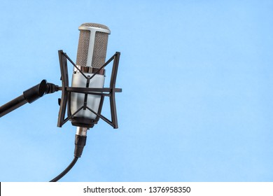 microphone isolated on blue background (Mic, condencer Mic, Voice Mic, Instrument Mic, Studio Mics, Microphones, condencer Microphone, Voice Microphone, Instrument Microphone, Studio Microphones)