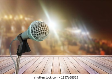 The microphone isolated on the blurry image of the stage in the meeting celebration festival during a night show abstract background.