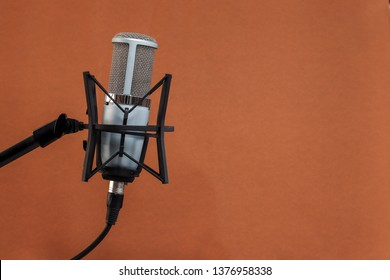 microphone isolated on brown background  (Mic, condencer Mic, Voice Mic, Instrument Mic, Studio Mics, Microphones, condencer Microphone, Voice Microphone, Instrument Microphone, Studio Microphones)