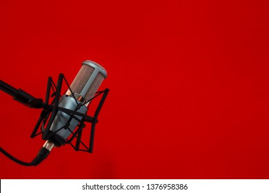 microphone isolated on Red background (Mic, condencer Mic, Voice Mic, Instrument Mic, Studio Mics, Microphones, condencer Microphone, Voice Microphone, Instrument Microphone, Studio Microphones)