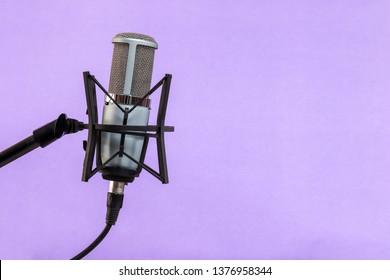 microphone isolated on violet background (Mic, condencer Mic, Voice Mic, Instrument Mic, Studio Mics, Microphones, condencer Microphone, Voice Microphone, Instrument Microphone, Studio Microphones)