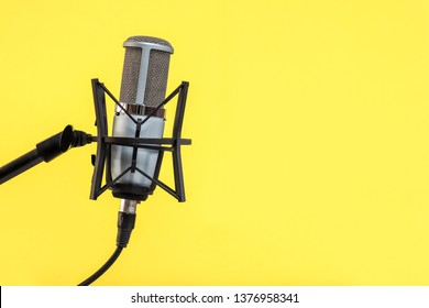 microphone isolated on Yellow background (Mic, condencer Mic, Voice Mic, Instrument Mic, Studio Mics, Microphones, condencer Microphone, Voice Microphone, Instrument Microphone, Studio Microphones)