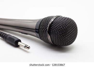 Microphone for a karaoke with a plug on a white background