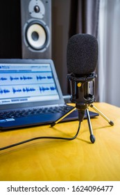 Microphone laptop and speaker podcast