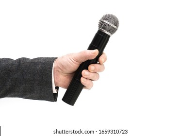 Microphone in male hand isolated on white