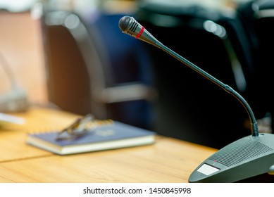 The microphone at the meeting room and the side book blurred.