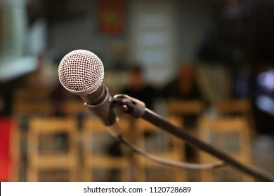 a microphone with a metal grid on the stage, will sing for the audience, a small concert hall