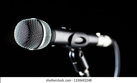 Microphone, mic, karaoke, concert, voice music. Closeup microphone. Vocal audio mic on a bleck background. Live music, audio equipment. Karaoke concert, sing sound. Singer in karaokes, microphones.