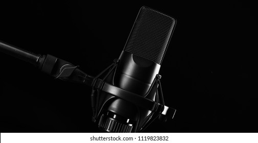 Microphone. Modern sound system equipment for a vocal performer. Mic isolated on black background.