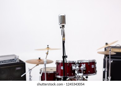 Microphone and music instrument. Microphone in a recording studio with drum on background.