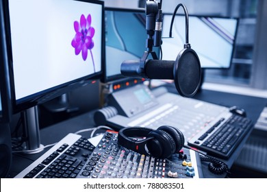 Microphone, Music Mixers And Headphones By Monitors In Radio Studio.