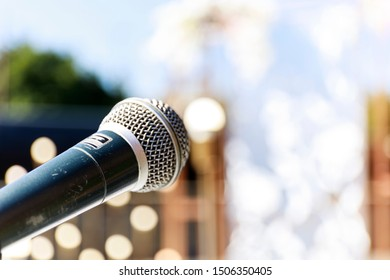 microphone on abstract blure light bokeh background