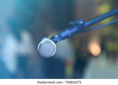 Microphone on abstract blurred hall lights.
