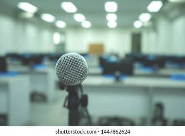 Microphone on abstract blurred of speech in computer room