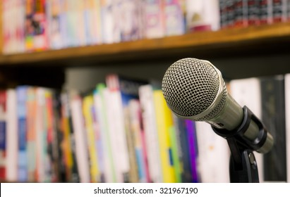 microphone on the background of blurred bookshelf  in library. soft focus .shallow depth of field. Vintage style and filtered process.