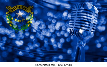 Microphone on a background of a blurry State of Nevada flag close-up